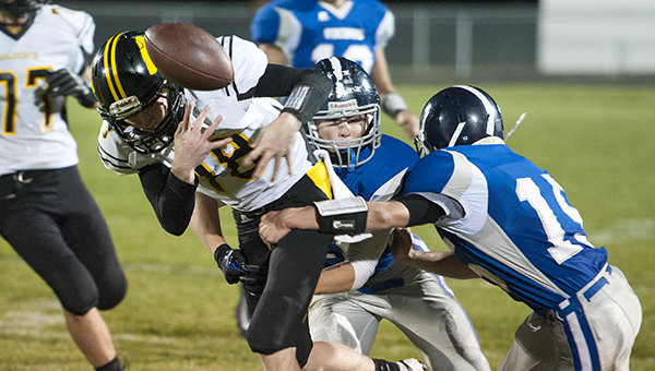 Northwood-Kensett's Hayden Halbach, middle, and Mason Olson, right, force a fumble by Janesville's Noah Dodd Friday in a matchup between the top two teams in the 8-Man District 3 standings at Northwood. — Micah Bader/Albert Lea Tribune