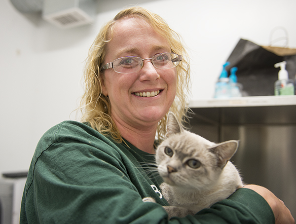 Christa DeBoer of the Humane Society of Freeborn County holds Baby Girl, a 13-year-old cat that was surrendered by an older owner who could no longer care for her. Baby Girl has since been adopted and will go to her new home soon. - Colleen Harrison/Albert Lea Tribune
