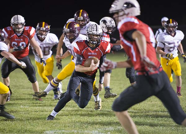NRHEG quarterback Palmer Peterson carries the ball during Wednesday's Section 2AA quarterfinals against Blue Earth at New Richland. - Colleen Harrison/Albert Lea Tribune