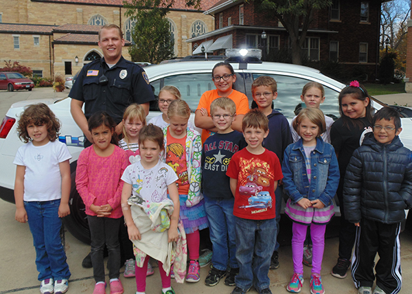Officer Evan Brown of the Wells Police Department recently visited kindergarten through fourth-grade students at St. Casimir's School in Wells. Brown spoke to the students about how to call 911, how to be safe when walking to and from school, and stressed the importance of staying away from drugs and other harmful substances. - Provided