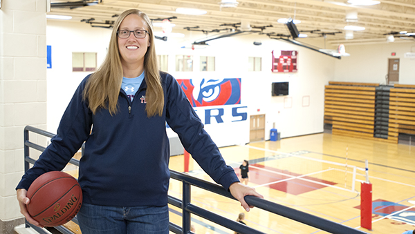 Albert Lea girls' basketball coach Gina Klennert holds a basketball Tuesday at the high school gym. Klennert was hired to take over the program in mid-June. - Micah Bader/Albert Lea Tribune
