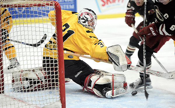Austin goalie Kristofer Carlson makes a stop during the first period against Minot Friday night at Riverside Arena. - Eric Johnson/Albert Lea Tribune