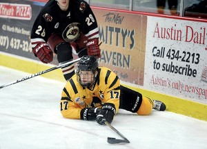Austin's Jade Miller looks for an outlet after hitting the ice in the second period against Minot Friday night at Riverside Arena. - Eric Johnson/Albert Lea Tribune