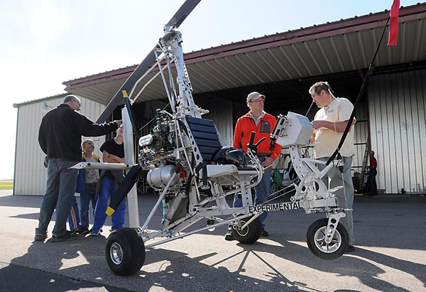 Guests check out a gyrocopter built by Denis Schoemaker, center, during an open house at Mankato Regional Airport in Mankato. - Pat Christman/Mankato Free Press