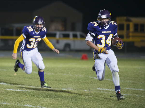 Lake Mills' Grant Fjelstad carries the ball during Friday's game against West Fork at Lake Mills. - Colleen Harrison/Albert Lea Tribune