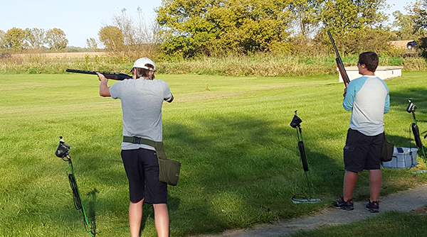 As part of the NRHEG clay target team, Albert Lea's Alex Romer, left, scores a 25 out of 25 as Caleb Hoffman looks on in Week 2 of competition. The Panthers lead Class A Conference 9 with 5,386 points to extend their lead over second-place Anoka, a team with 4,564.5 points. - Provided