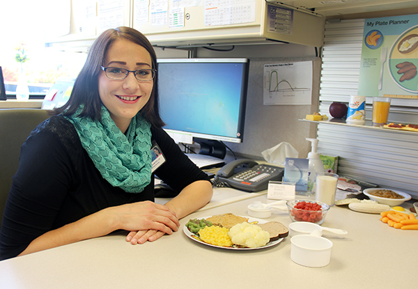 "Mayo Clinic Health System in Albert Lea dietitian Emily Schmidt showcases a healthier plate of food. Schmidt will present a free program titled ""Holiday Eating and Diabetes"" on Nov. 2. - Sarah Stultz/Albert Lea Tribune"