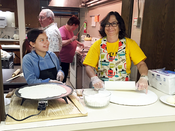 Kesi Titus and Michelle Cardona aid in making lefse for the annual fall bazaar on Nov. 7 at Ascension Lutheran Church.  - Provided