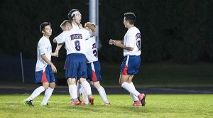 Colton Mowers, third from left, of Albert Lea celebrates with his teammates after scoring a goal Sept. 29 against Mankato West at Jim Gustafson Field. - Micah Bader