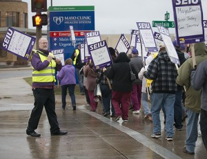 Maintenance workers from Mayo Clinic Health System in Albert Lea, along with supporters and SEIU representatives, picket outside of the hospital Monday. - Colleen Harrison/Albert Lea Tribune
