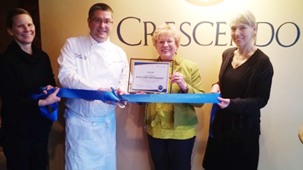 Ellen Kehr, Blue Zones Project organizational lead, presents Crescendo's with a certificate for becoming a designated Blue Zones restaurant. Raissa Byer, Crescendo's owner/chef Bob Tewes and Darcy Netzer were part of the celebration. - Provided
