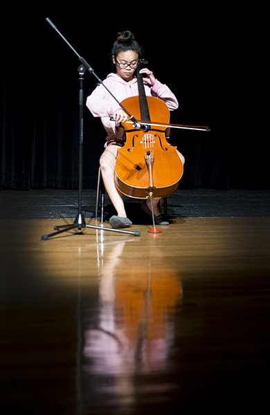Abby Sencio performs a Bach suite on the cello during rehearsals for Albert Lea High School's Tigers' Roar talent show. - Colleen Harrison/Albert Lea Tribune