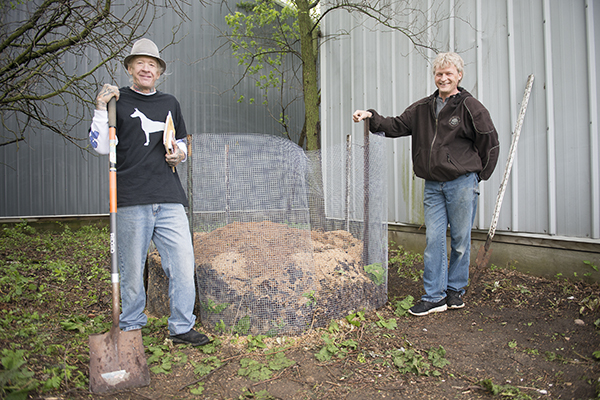 Mike Haskins, left, and Del Schroader stand next to the first compost bin made for Code Brown — a dog waste removal and upcycling business Haskins started that is housed on Schroader's Staycation Pet Care property. - Colleen Harrison/Albert Lea Tribune