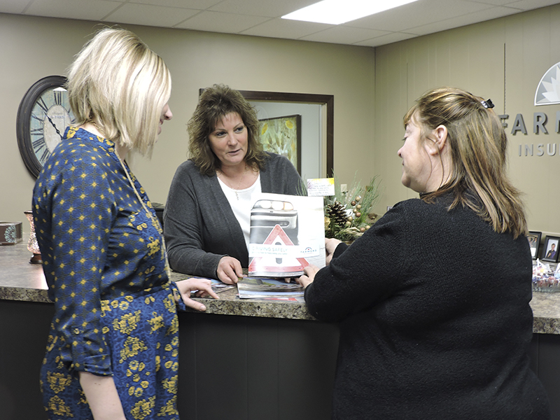 Lyssa Warmka, left, is new to the agency; however, Jackie (Brandenburg) Wetzel, center, has worked at Farmers Insurance in Wells for 18 years. Wetzel assists Warmka with the day-to-day dealings of the agency including networking with NuStar Realty Realtor Kimberly Huper, right. - Kelly Wassenberg/Albert Lea Tribune
