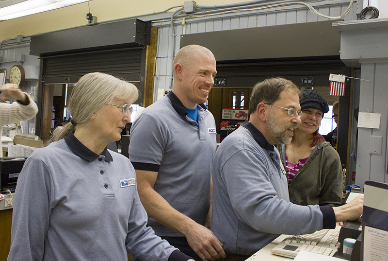 Barb Ahles, Jeff Kopseng, Stangeland and Holly Melom work Feb. 5. Stangeland credits the team with assisting him in doing his job. - Sam Wilmes/Albert Lea Tribune
