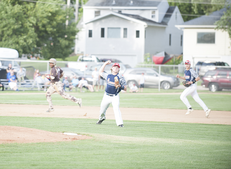 Albert Lea's Parker Mullenbach makes a throw from the infield grass during Thursday's game against the Military All-Stars.