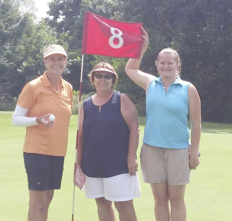 From left, Karen Gimberline, Sharon Honstad and Beccas Bryson. Gimberline scored a hole-in-one on the Par 3 8th Wednesday, July 6 at Oak View Golf Course in Alden. Provided