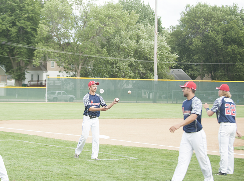 Albert Lea's Mason Hammer plays toss with a teammate before the game Thursday at Hayek Field.