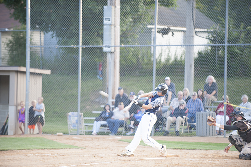 Albert Lea's Jake Thompson strokes a double in the fourth inning of Thursday's game. He went 2-6 with an RBI.