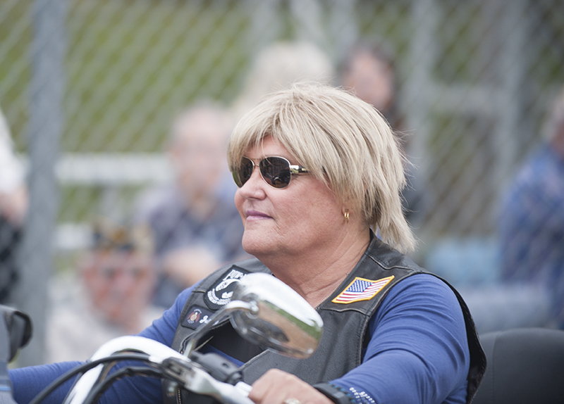 A Legion rider makes her way around the field for a ceremonial lap before Thursday's U.S. Military All-Star Game at Hayek Field.
