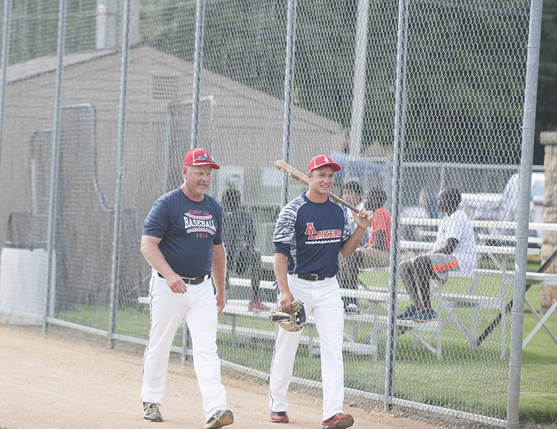 Assistant coach Jay Enderson, left, and first baseman Mason Hammer have a conversation on their way to batting practice Thursday at Hayek Field.