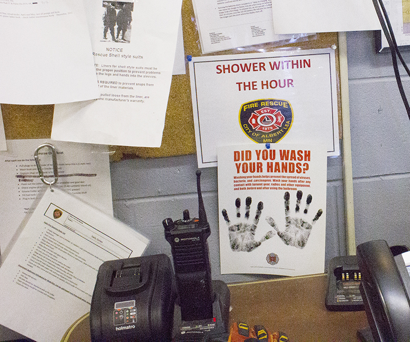 The Albert Lea Fire Department is trying to combat the risk of cancer for firefighters by education at its station, as evidenced by a preventative sign. - Sam Wilmes/Albert Lea Tribune