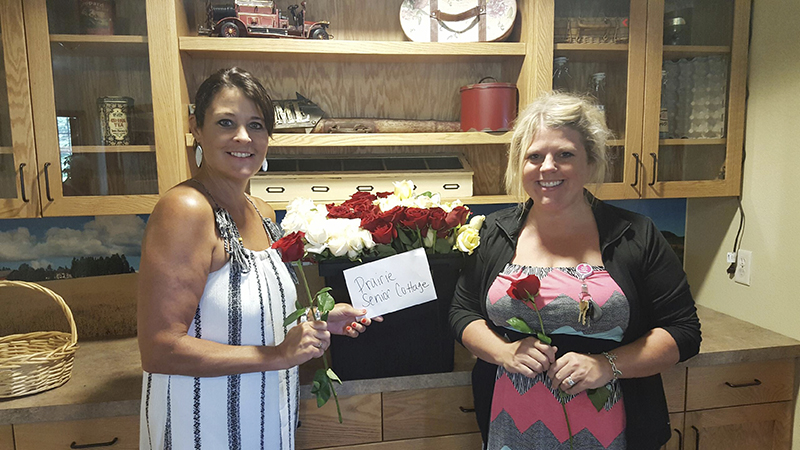 Staff at Prairie Senior Cottages accepted roses on the behalf of their residents from Hy-Vee customers who participated in a recent giving campaign. Roses were delivered to a number of other facilities as well. - Provided