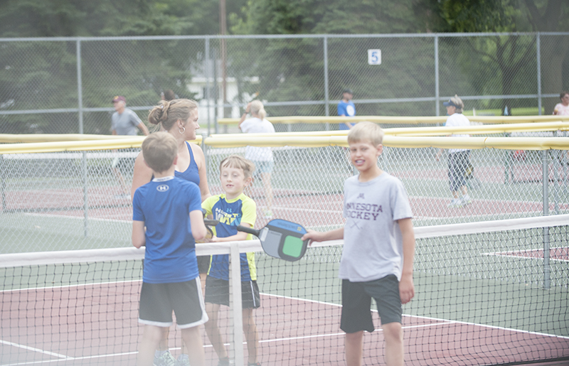 A group of young pickleball players congratulate each other after a game played at the pickleball courts at Frank Hall Park Thursday evening. Jarrod Peterson/Albert Lea Tribune