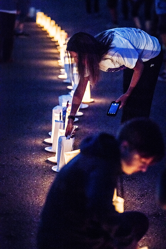 Luminarias are lit Friday during the American Cancer Society's Freeborn County Relay for Life to  represent those who have died from cancer, those who have survived cancer and those who are still battling cancer today. - Colleen Harrison/Albert Lea Tribune