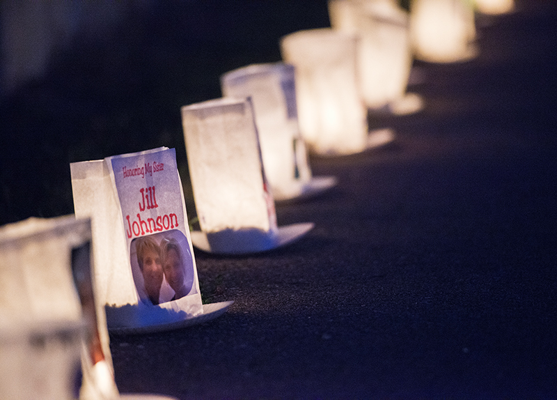 Lit luminarias line a path Friday at the American Cancer Society's Freeborn County Relay for Life. - Colleen Harrison/Albert Lea Tribune