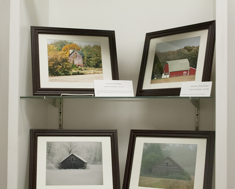 """A unique painting of a barn on a piece of wood is one of many paintings displayed at the Albert Lea Art Center's latest gallery, """"Barns are Noble."""" - Henry Rohlf/Albert Lea Tribune"""