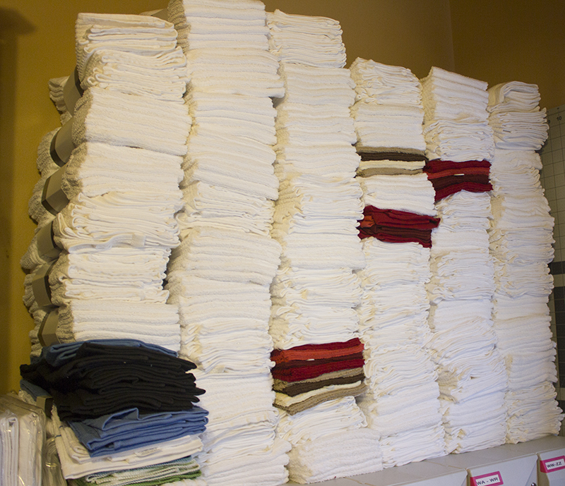 Stolaas has created more than 435 towels, many of them for breast cancer awareness. Shown here are dozens of towels in Stolaas' home. - Sam Wilmes/Albert Lea Tribune