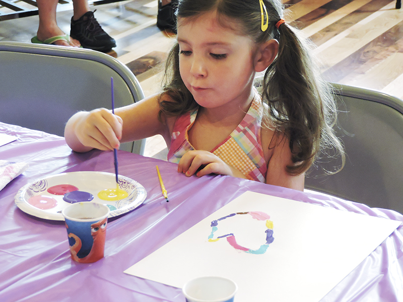 Laina LaFrance, 5, paints during the Art and Healing Day for Sophie. Her mother, Nicole, volunteered at the event. - Kelly Wassenberg/Albert Lea Tribune