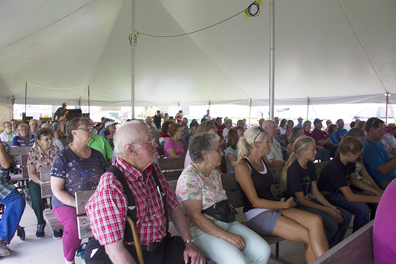 The crowd listens to the 2016 Freeborn County Outstanding Senior Citizen and Agriculture Hall of Fame Ceremony Wednesday at Freeborn County Fairgrounds. - Sam Wilmes/Albert Lea Tribune