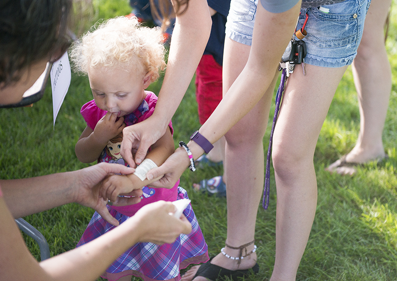 Multiple children's activities were available at Rally for Civility on Friday at New Denmark Park, including temporary tattoos. - Colleen Harrison/Albert Lea Tribune