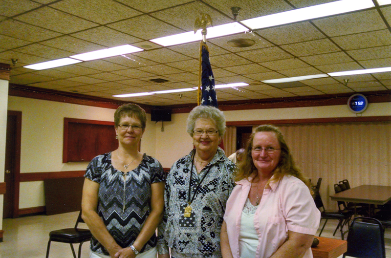 The newest sisters to join the Fraternal Order of Eagles No. 2258 Auxiliary are Tracy Bennett, far left, and Julie Thiele, far right. Madam president of the Eagles Auxiliary is Connie Wadding, center. - Provided