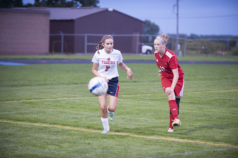 Albert Lea attacker Lucy Sherman watches as Fairmont defender Morgan Shriver kicks the ball out of bounds in the first half of Monday's match.
