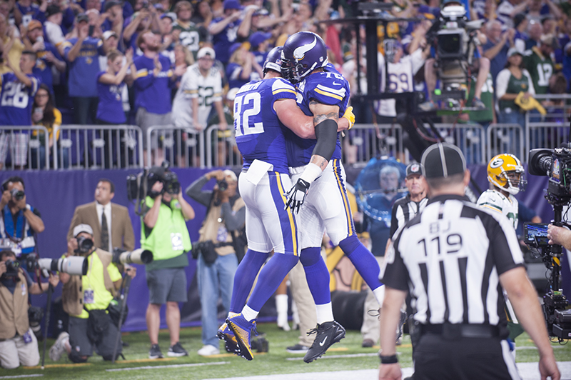 Minnesota Vikings tight end Kyle Rudolph, left, jumps into the arms of guard Alex Boone after Rudolph's second-quarter touchdown catch that tied the game Sunday night. Jarrod Peterson/Albert Lea Tribune