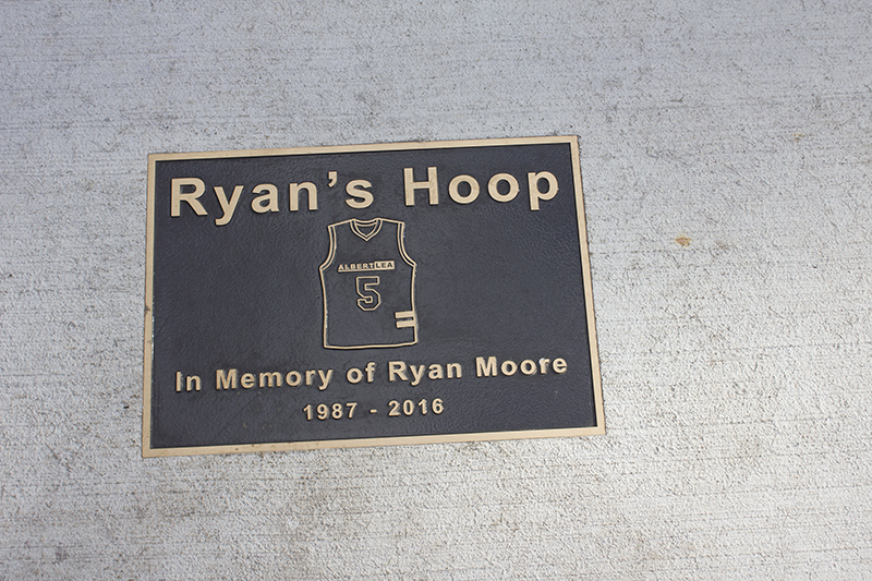 A plaque bearing Moore's No. 5 Albert Lea High School jersey is on display at the court dedicated to him at Oakwood Park. — Sam Wilmes/Albert Lea Tribune