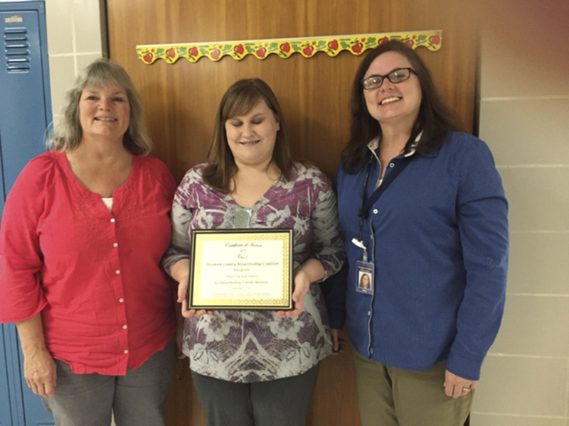 Cindy Gaudian, left, of the Freeborn County Breastfeeding Coalition presents Dani Bryant, center, with an award for leading the effort to have a lactation room at the high school and Alice Englin, Freeborn County SHIP coordinator for assisting with the project. - Provided