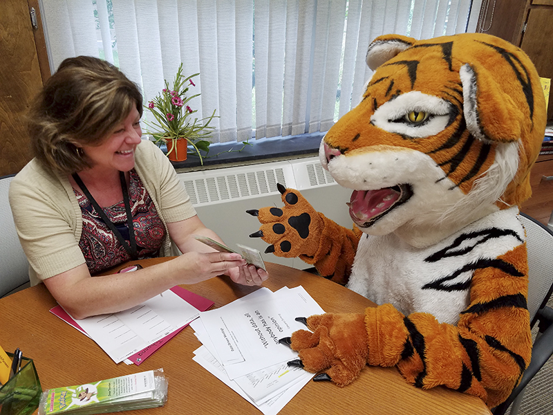 Halverson Elementary School Principal Johanna Thomas talks with the Albert Lea Tigers mascot. -Provided