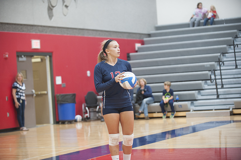United South Central senior outside hitter Tyra Johnson gets ready to serve the ball in the first set of the match between USC and Alden-Conger.