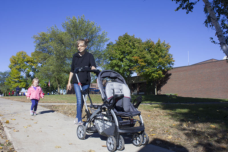 Tonia Tuttle and her daughter, Olivia Dempewolf, walk Friday during the Lakeview Elementary School walkathon. — Sam Wilmes/Albert Lea Tribune