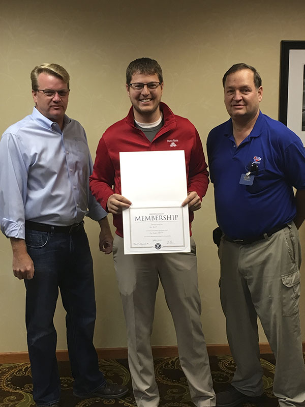 Albert Lea Daybreakers President Matt Greibrok, left, and Treasurer Chuck Karl, right, welcome new member Ben Bartelt, center, to the Daybreakers Club. Bartelt is employed with State Farm Insurance on Bridge Avenue in Albert Lea. - Provided