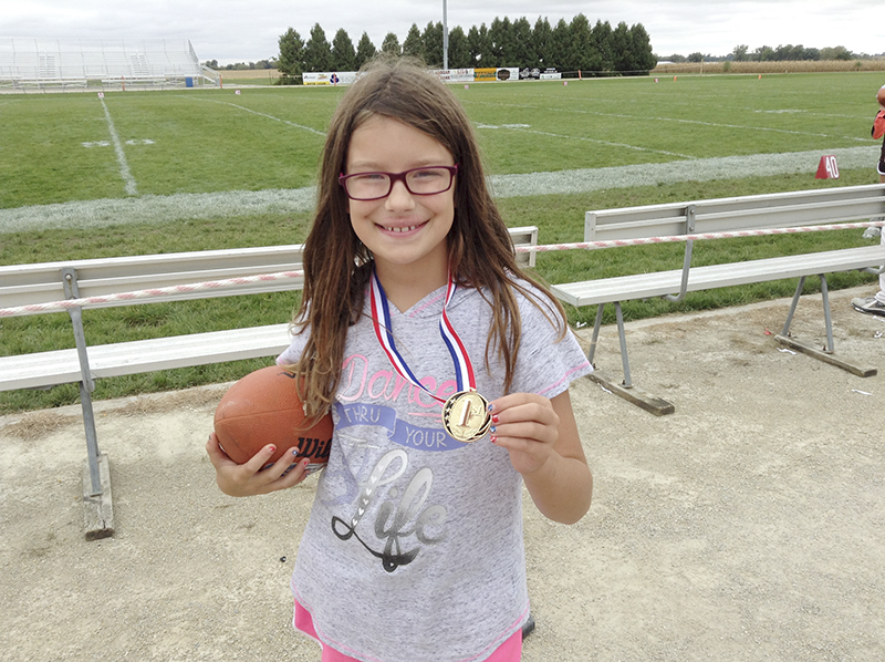 Alexis Jones of Albert Lea captured first place for the 10-11-year-old girls in the Punt, Pass and Kick competition held Oct. 1 in St. Ansgar, Iowa. She will advance to the sectional competition to be held Saturday in Mason City. Provided