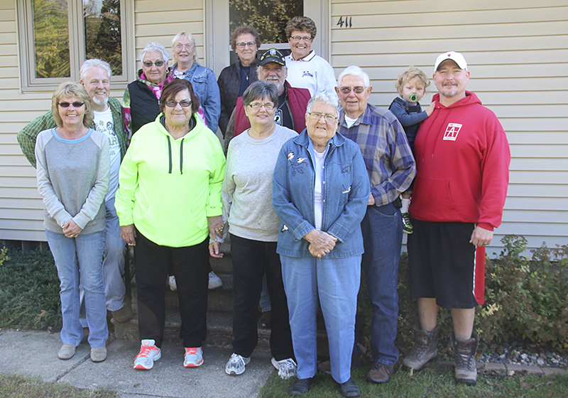 Members of the Glenville American Legion Auxiliary, American Legion and Sons of the American Legion, among others, participated in a service project for two Glenville veterans on Saturday. - Sarah Stultz/Albert Lea Tribune