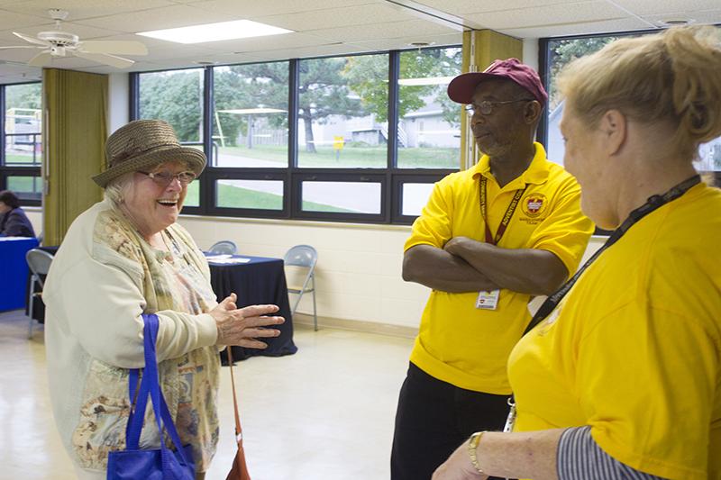 Albert Lea resident Katie Koziolek, left, and Adventist Community Services volunteers Andrew Thompson and Jan Flowers talk Monday at the multi-resource agency center at United Methodist Church. — Sam Wilmes/Albert Lea Tribune