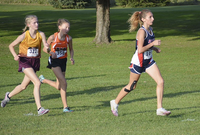 Albert Lea's Autumn Muilenburg pulls away from some opposing runners during Tuesday's meet in Austin. Muilenburg came in sixth place for the Tigers. Lon Nelson/For The Albert Lea Tribune