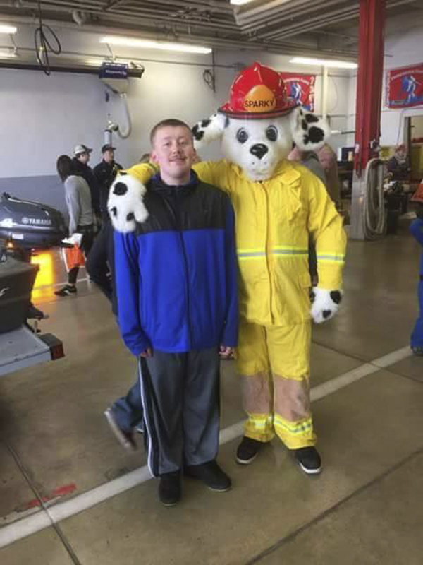 Sparky visits with Slater DeRaad during Albert Lea Fire Department's open house Oct. 10. - Provided
