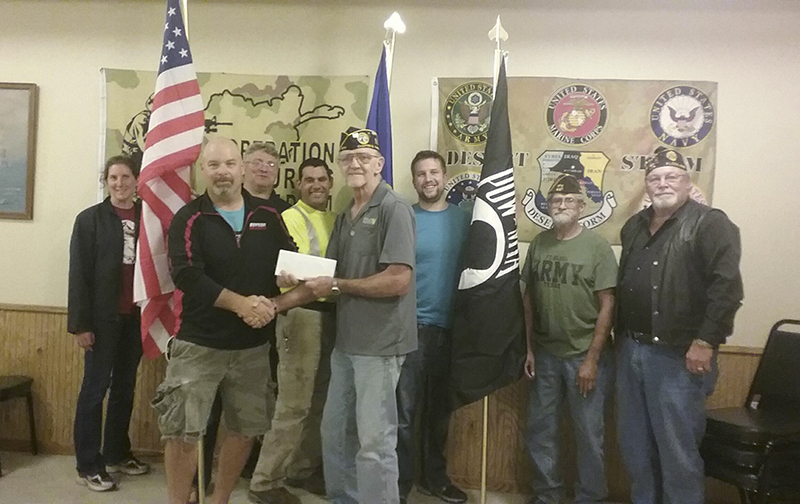 Kory Newman of the Bayside Ski Club recently received a donation from Larry Wiegel of the Disabled American Veterans Chapter No. 16, Joe Avalar of Veterans of Foreign Wars Post No. 447 and Gary Newman of American Legion Post No. 404. Ski club members Sara Wenner, Mike Johnson, Ike Dulas and Erik Johnson were also on hand to accept the donation. -Rich Mirelli/Albert Lea Tribune